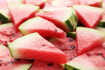 Tasty slices of watermelons background