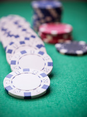 selective focus shot of poker chips on green table