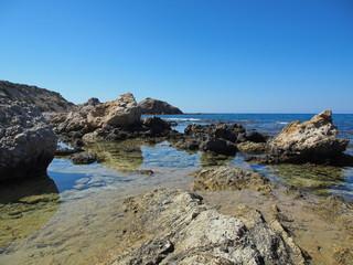 steel water reflecting rocks