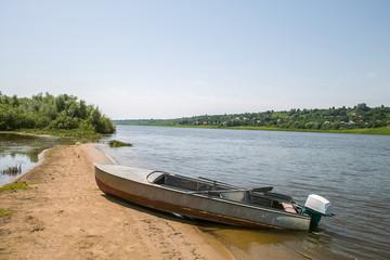 True fisherman boat on the Oka river, Russia.