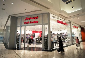 Local woman is seen walking in front of the Foot Locker store at Bahrain City Center in Manama