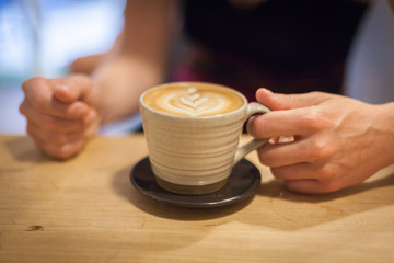 cappuccino on a wooden table ready for you to enjoy