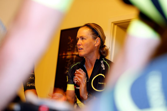 Greer Sansom, an Australian triathlon coach, instructs spinning class during a weekly training session at her club in Manama