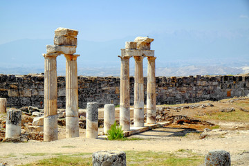 Beautiful view of ancient columns on sunny day