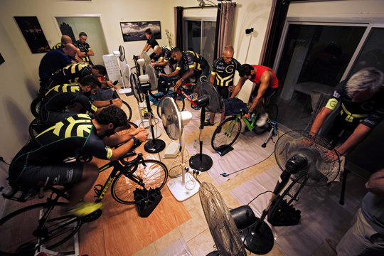 Bahraini tri-coach Jasim Al Bastaki instructs spinning class during a weekly training session at his club in Manama