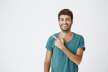 1ab4ad71287b Isolated studio portrait of happy attractive caucasian guy in casual blue t- shirt