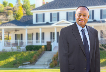 African American AgentIn Front of Beautiful Custom House.