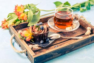 Picture of cake, blueberries, black tea