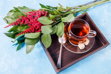 Picture of black tea, red flowers
