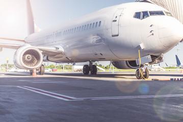 Big passenger aircraft locating at runway