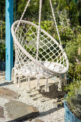 Cozy place to relax in the garden, white rope chair.