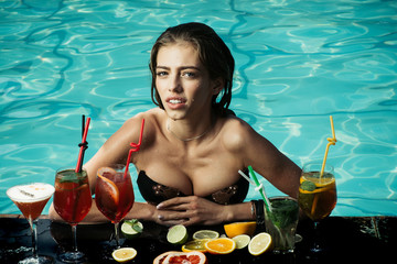 Woman with alcoholic beverage and fruit.