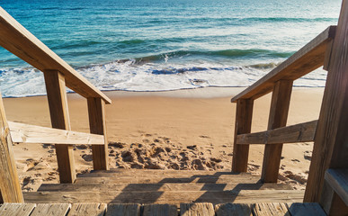 Wooden stairs to the beach in Tarifa, Andalusia, Spain