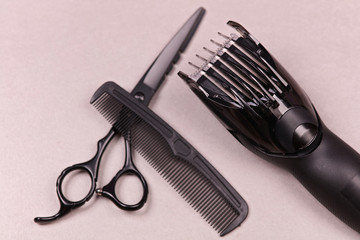 Hairdresser tools : Scissors , comb and trimmer for hair styling on gray background