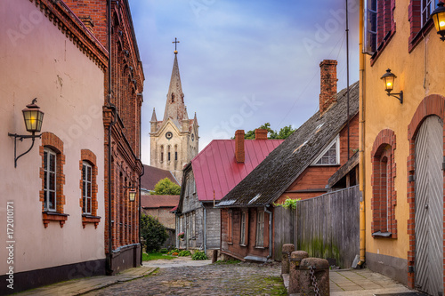 Wall mural Empty cobblestone streets and church tower in the small town of Cesis