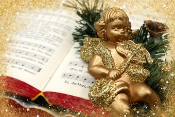 Gebetbuch mir Weihnachtsengel eingerahmt mit glitzernden Sternen