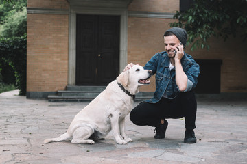 A guy with a dog