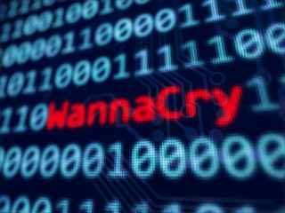 WannaCry red text between blue binary data background blue screen 3d rendered with depth of field