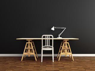 Schreibtisch vor grauer Wand