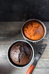 Hallowen orange and brown baked cakes in round cake pans