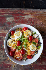 garden salad with tomatoes, cheese, and eggs top view