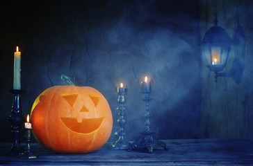 Halloween pumpkins on wooden table on dark background