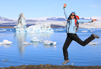 Girl jumping on the coast of the glacial lake Jokulsarlon