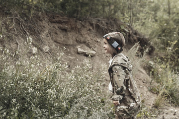Young boy with gun, laser tag, war simulation