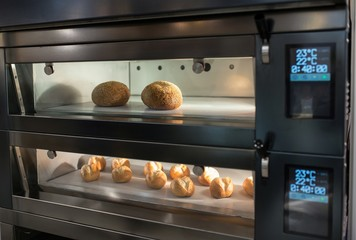 Zelfklevend Fotobehang Brood Baking bread in automatic oven