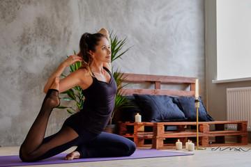 Sexy brunette female doing yoga.