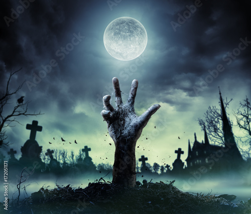 Fotobehang Zombie Hand Rising Out Of A Graveyard