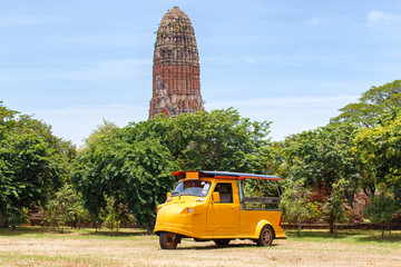 Tuk Tuk car tourist at parking outdoors with Wat Mahathat background, Ayutthaya Province, Thailand