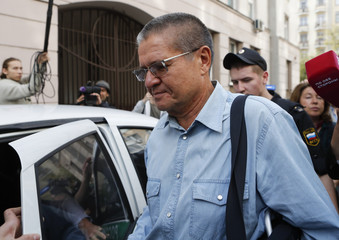 Russian former Economy Minister Ulyukayev is escorted after a court hearing in Moscow