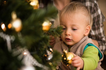 Closeup shot of a kid near xmas tree