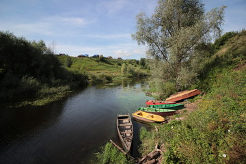 Boats in green river