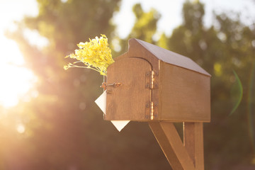 A letter box at the house. The postman sends a letter. Receiving a greeting card