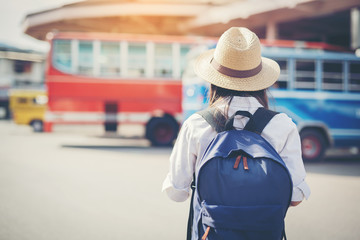 happy female tourist on map  to Bus station vacation.Travel concept.