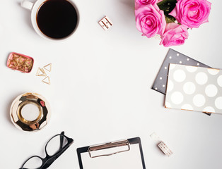 Feminine workplace concept: cofee, roses and small gold color accessories