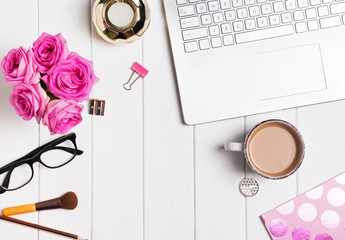 Modern stylish feminine workplace with coffee and roses