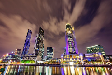 A view across the Yarra river atthe landmark of Melbourne downtown during the city's nightime..