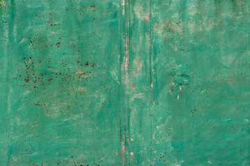 Rusty metal surface with blue paint flaking and cracking texture