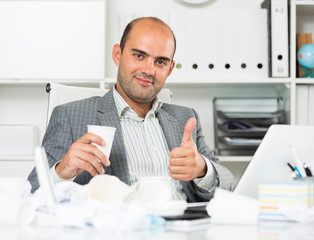Cheerful businessman enjoying the excellent results