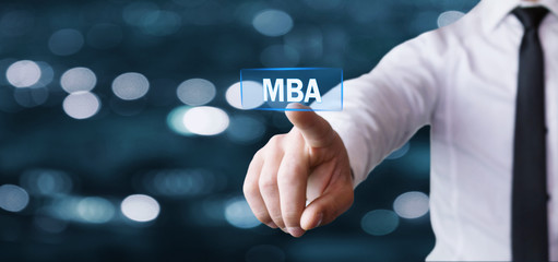 Businessman hand touching MBA text.