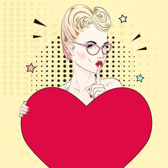 Comic Pop art blonde hair woman face with kiss mouth in glasses calls for silence and holds a red heart. Vector illustration.