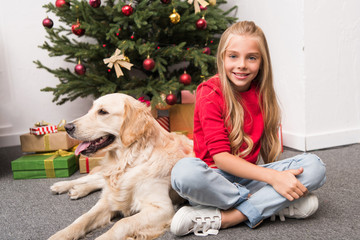 child with dog at christmas