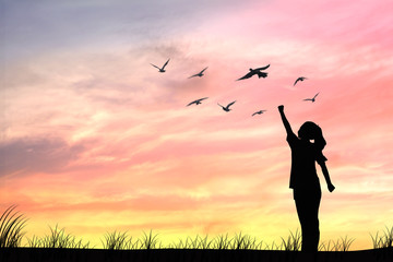 Silhouette women and dove birds flying, concept as hope and freedom