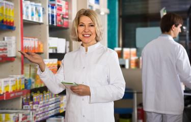 mature woman pharmacist working