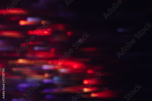 Abstract Background Of Colorful Lines In Motion On Black Bokeh Of