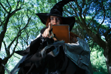 Photo of witch in hat with book