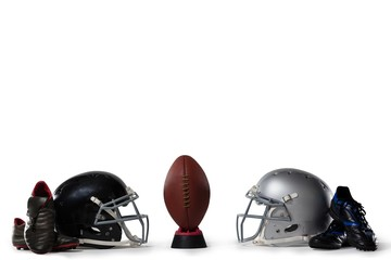 American football on tee by sports shoes and helmets
